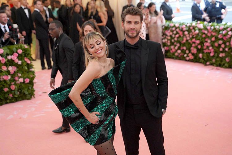 "NEW YORK, NY - MAY 6: Miley Cyrus and Liam Hemsworth attend The Metropolitan Museum Of Art's 2019 Costume Institute Benefit ""Camp: Notes On Fashion"" at Metropolitan Museum of Art on May 6, 2019 in New York City. (Photo by Sean Zanni/Patrick McMullan via Getty Images)"
